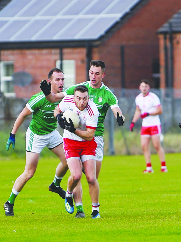 Kevin Quinn evades Gerard McCann during last year's quarter-final replay when Cargin dethroned Lámh Dhearg. The teams return to Corrigan Park for the final this Sunday with the Red Hands aiming to redress the balance against the defending champions