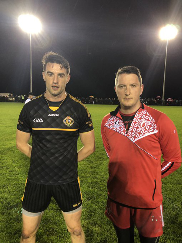 HEAD TO HEAD:Portglenone captain Niall McKeever with Lámh Dhearg captain John Finucane, right, ahead of Monday night's second replay at Ballymena