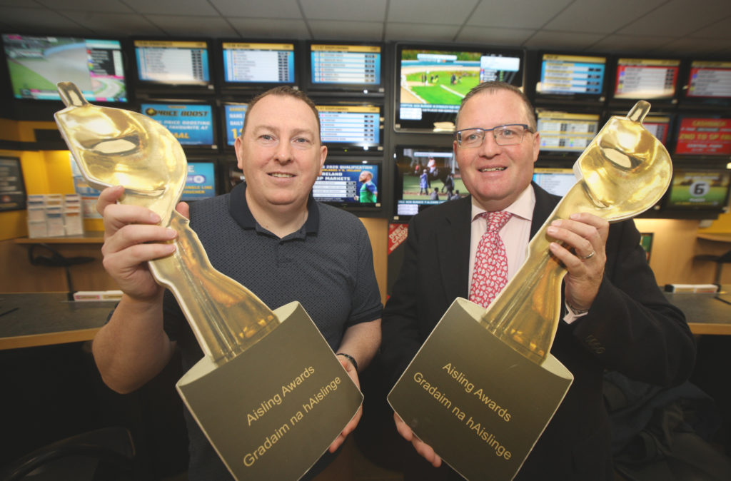 Gerard Mulhern from the Andersonstown News and Brian Graham from Sean Graham bookmakers launch the Aisling Sports Award
