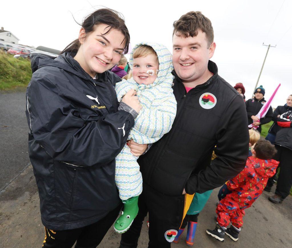 West Belfast 'superhero' Dáithí Mac Gabhann and his parents Seph and Máirtín wrap up warm with others to walk Divis Mountain as part of Féile na Carriage