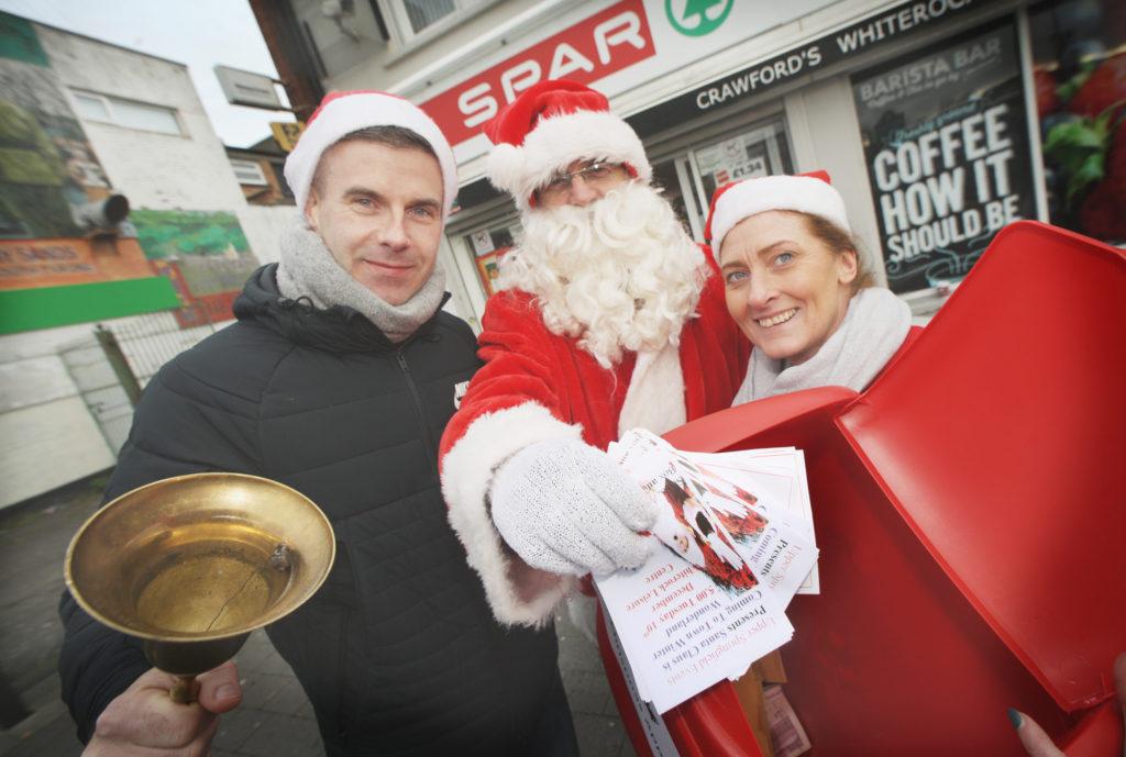 Sinn Féin Councillor Steven Corr along with Patricia Monahan help Santa raise funds for local families in the run up to Christmas