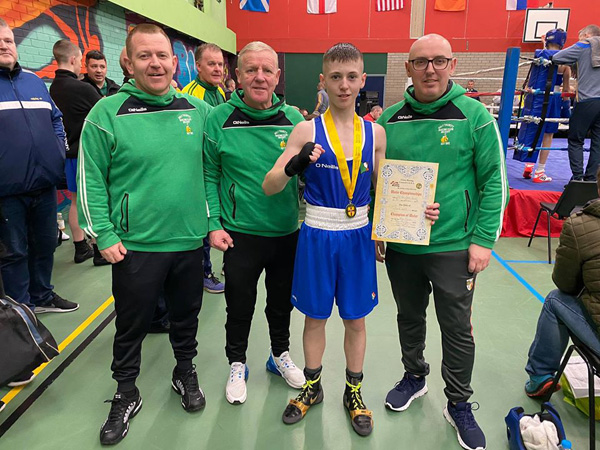 Holy Trinity's Kyle Smith celebrating his Ulster title win in Newry at the weekend with club coaches Michael Hawkins, Ciaran Scullion (left) and Robert Fisher (right)