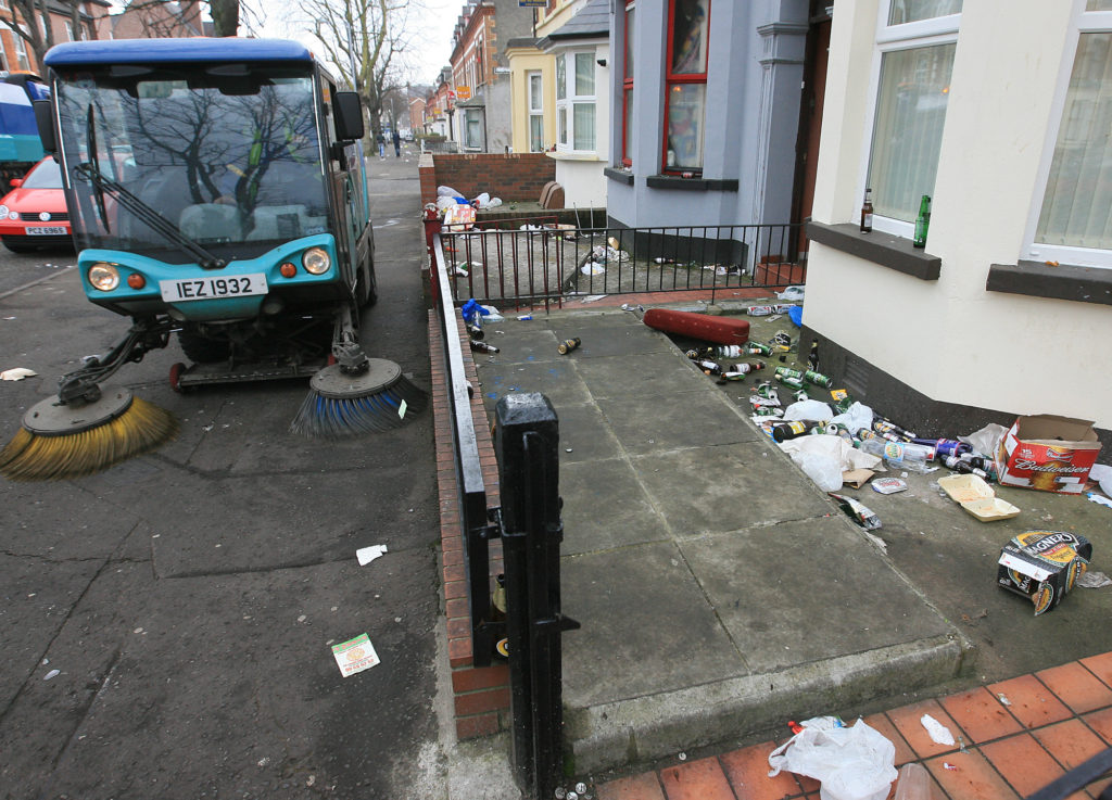 CLEAN UP: The aftermath of a street party in the Holylands area of South Belfast
