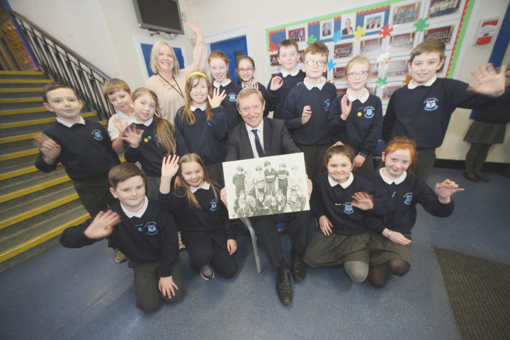 NOW AND THEN: Holy Child  Primary School's current councillors and vice-principal Mrs Deery wish Mr Short good luck with his retirement