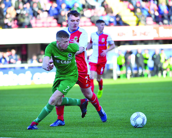Newington's Michael Gallagher pictured in action against Linfield Swifts in the Steel and Sons Cup final on Christmas Day.