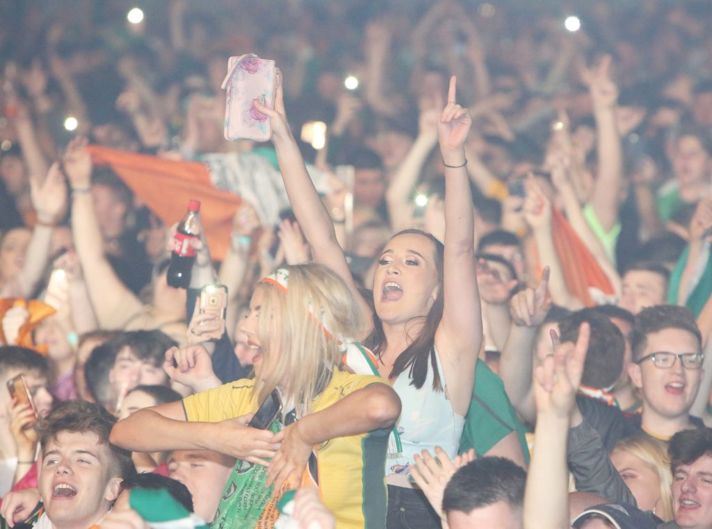 THE WAY WE WERE: Cheering fans of the Wolfe Tones throng the Falls Park in August 2019 during the Féile an Phobail finale