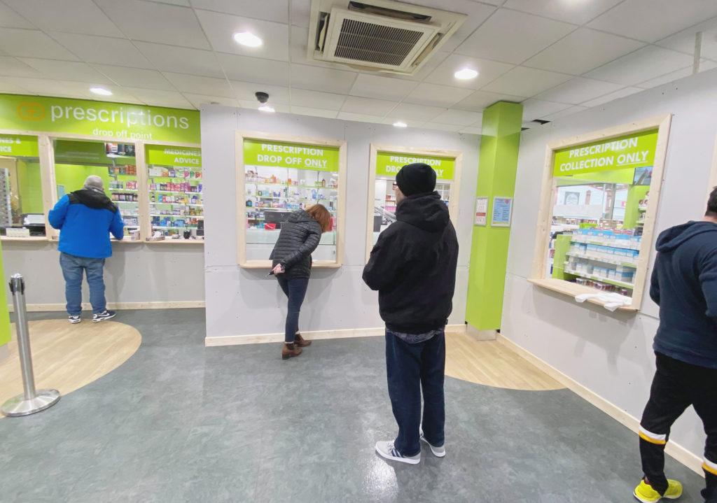 Windows go up in West Belfast chemist shops