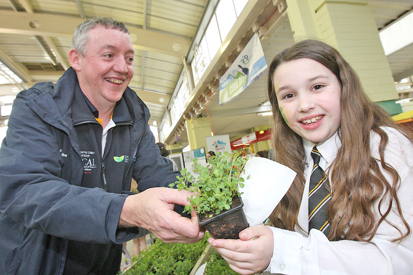 A Library picture showing Mickey George celebrating the Colin Creativity Day at the Dairy Farm with schoolgirl  Sianna Morgan.