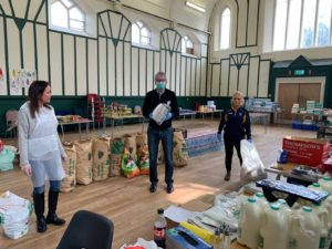 FOOD BANK ON FRONTLINE: Belfast Media Group's Máirtín Ó Muilleoir Delivering PPE face shields to the volunteers Nicola Bradley and Jackie Donnelly at the North Belfast Food Bank today